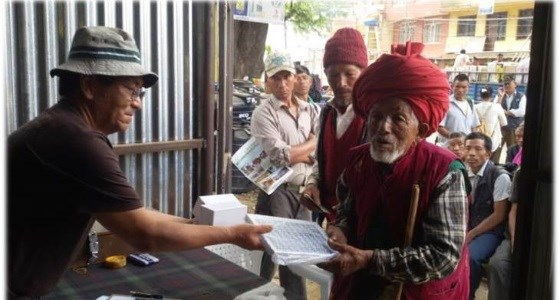 A Welfare Officer in Kathmandu distributing solar lights to Gurkha veterans