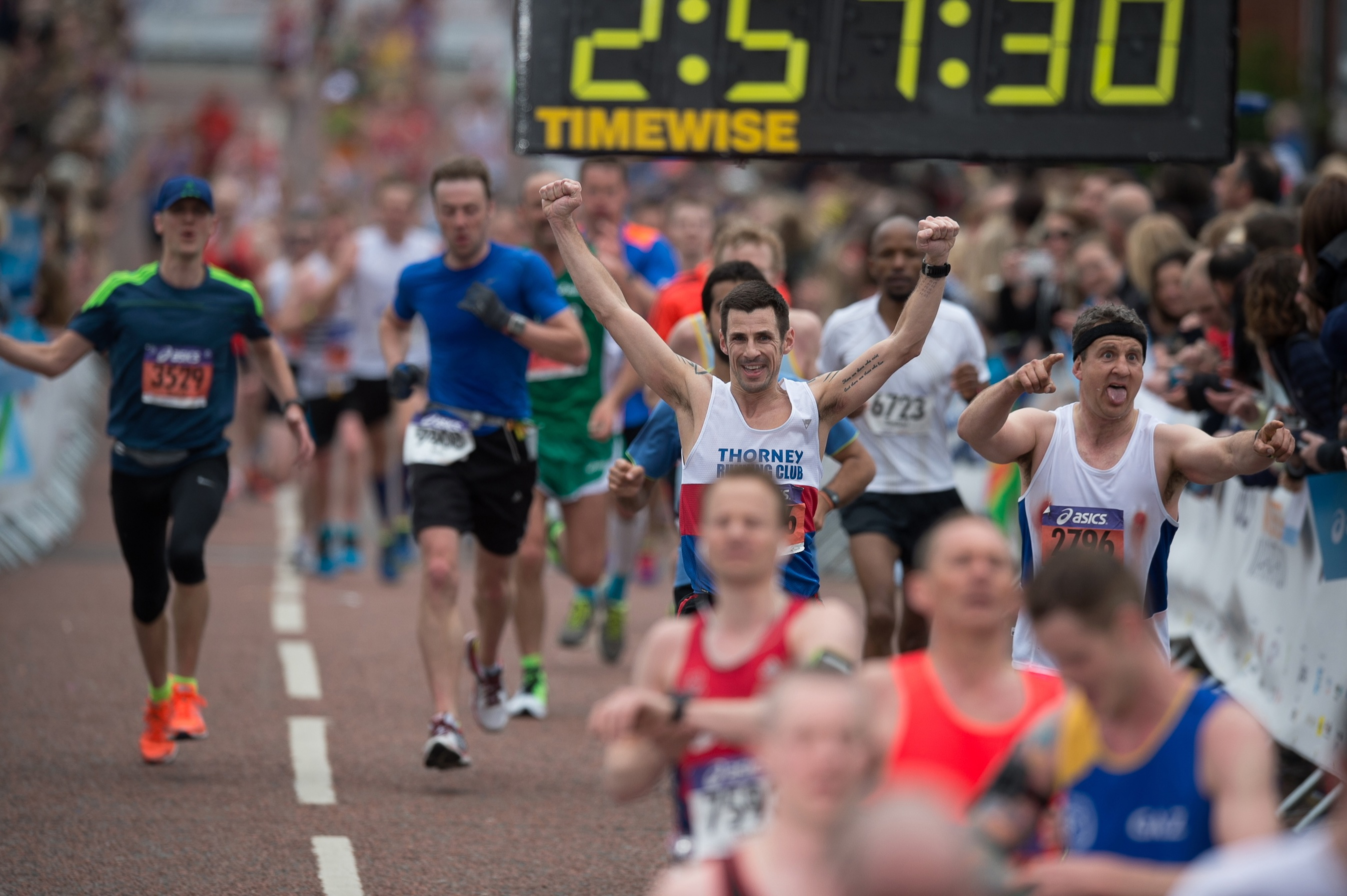 Group of men running the Manchester Marathon