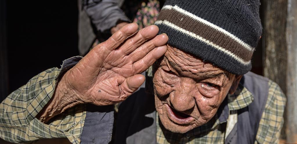 Gurkha veteran in hat saluting