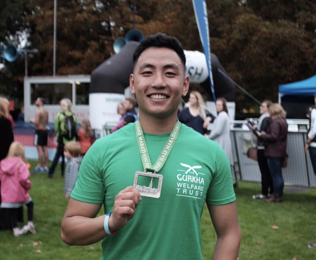 Gurkha soldier with medal after running marathon