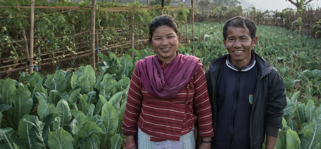 Nepali couple with their farm crops