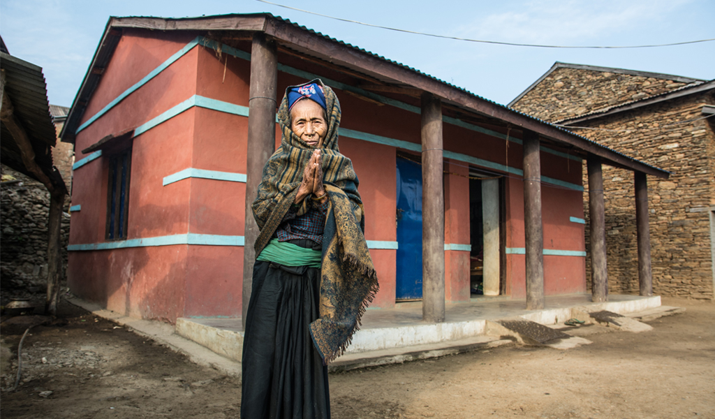 Elderly Nepali Widow Woman standing home house