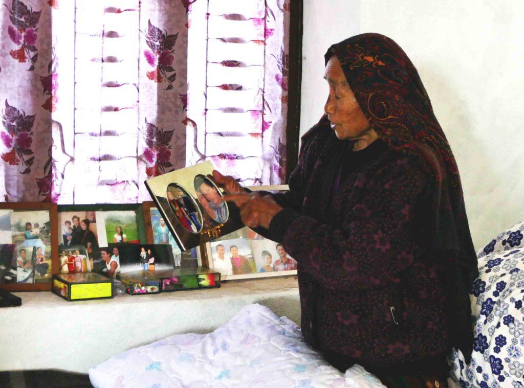 lady pointing at photo, Gurkha widow, Gurkha, Gurkhas, World War Two, Hearing loss, Family secret, Nepal, Nepali lady, Nepali woman, Nepalese